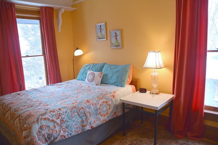 Yellow room with new bedding.