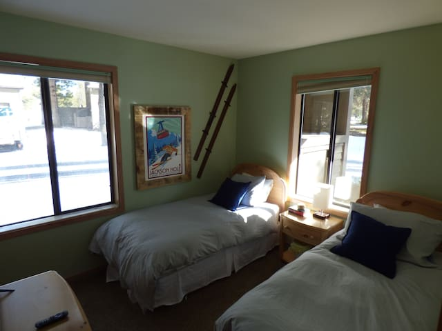 Bedroom downstairs has two twin beds and a large TV for the kids