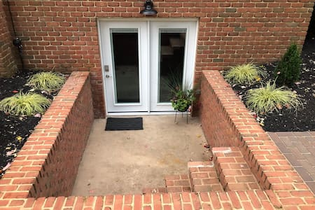 This is the main entrance door with privacy blinds and smart lock