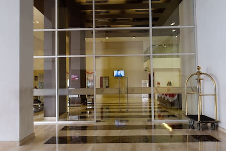 This is the entrance to the main lobby as seen from outside, there is adequate lighting outside and inside as well.