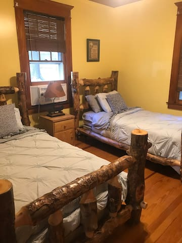 Bedroom 2:  2 twin costume made log beds!
