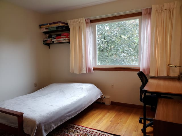 Bedroom three has a full size futon bed, a large closet, a desk and an office chair.