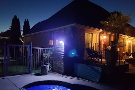 city light keeps parking area well lit.  Solar LED lights will activate as you approach the side gate.  Porch light will be lit for you if you plan a late arrival.