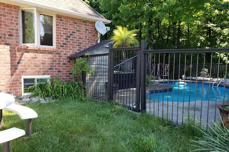 wide gate leads to rear deck entrance, next to the invround salt water pool.