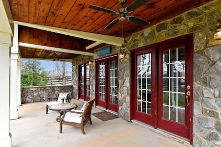 "Triple French doors that ""sit flat"" on the patio provide easy access & egress to/from the cottage."