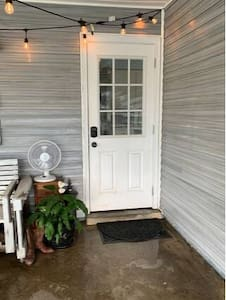 Carport door has a small step up. Approximately 3-4 inches high.