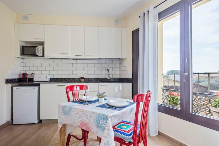 FH2 Apartamento de pueblo con terraza compartida.