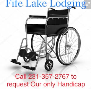 Please call ahead to request our only handicap assessable room. This room has two queen beds that are a bit lower, a shower with foldable mounted seat, a table & 4 chairs, a relaxing chair, microwave, coffee pot & condiments, mini fridge.