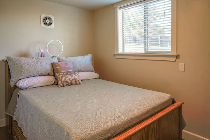 Cottage bedroom with queen bed and dresser