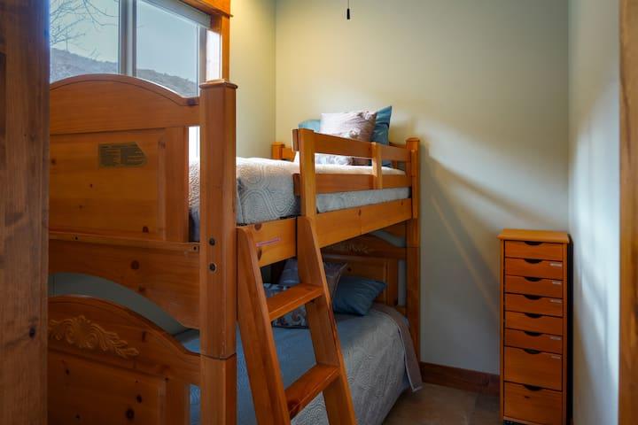 Bunk beds in main house (connected to queen bedroom w/ door leading to back patio)