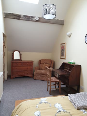 Rafters Room:  Double room with writing bureau and armchair