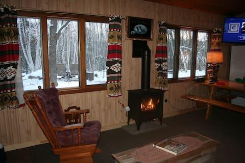 Rustic, remote lake cabin w/fishhouse & snowshoe