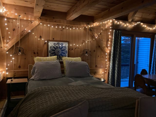 Bed with extra pillows and comforter ....with romantic lighting!