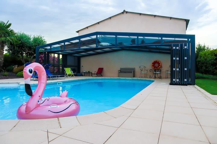 Maison agréable avec piscine couverte et chauffée