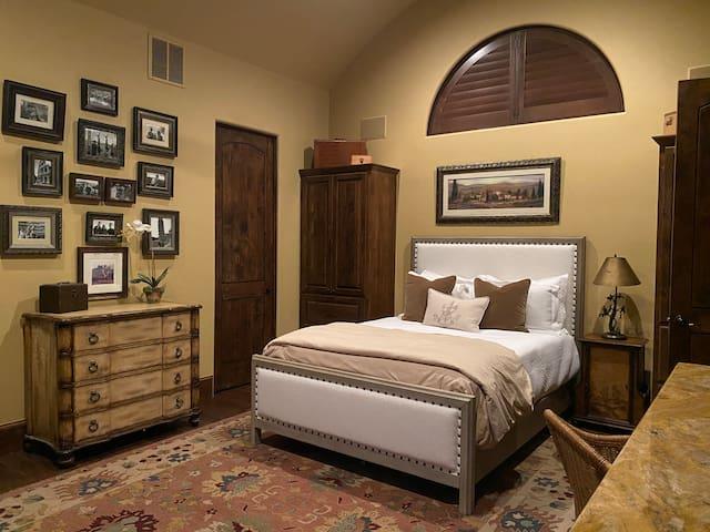 Tuscan Suite with Queen bed and ensuite bathroom. Double doors open to Juliet balcony overlooking Lake Travis.