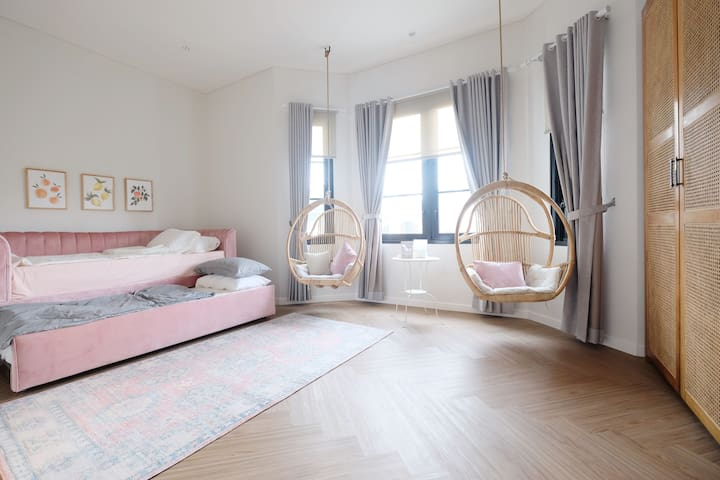 Dreamy bedroom 2 with trundle bed and hanging chairs. Comfortable sleeping for two people with plenty of floor space.