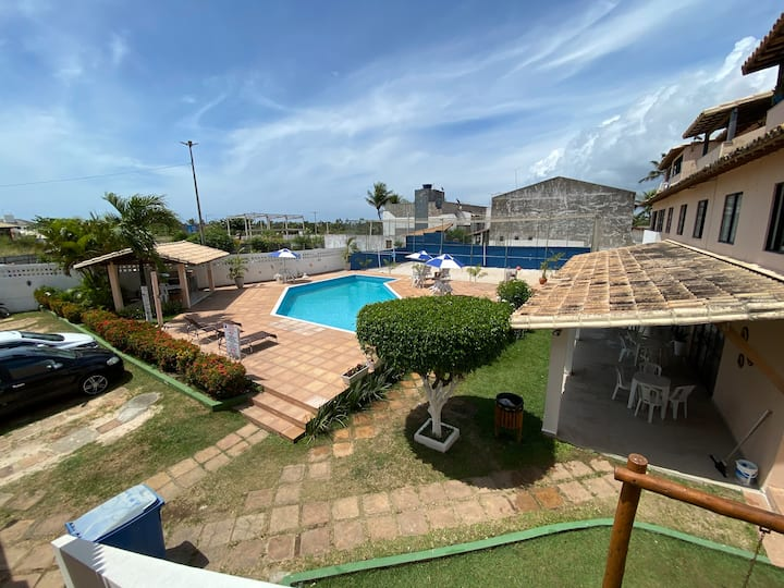 Village (Kitnet) com piscina, à 400mts da Praia
