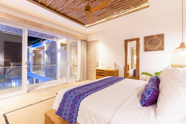 Second floor bedroom with private en-suite bathroom, king size super comfy bed and swimming pool view
