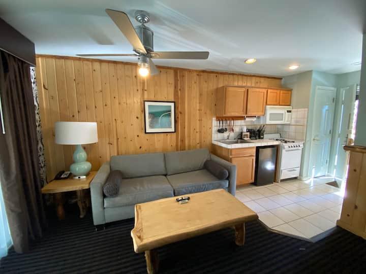 1 Bedroom King - Living Room, Fireplace & Kitchen