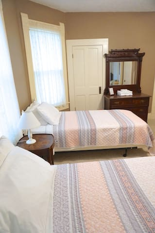 Two twin beds and one queen bed are available in the Veranda room for a total of 4 guests. This delightful suite includes a kitchenette and screened in second story porch.