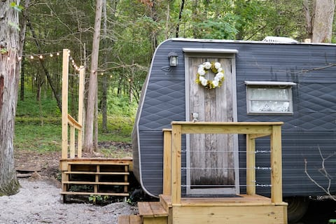 Retro Camper with Deck in the Tennessee Woods