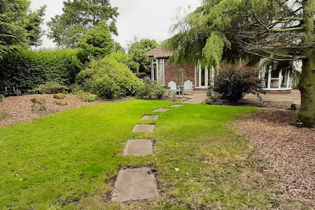 paved walkway to the bungalow