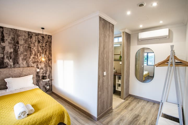 Comfortable luxurious feeling En-suite Bedroom, with Air-conditioning and changing area.