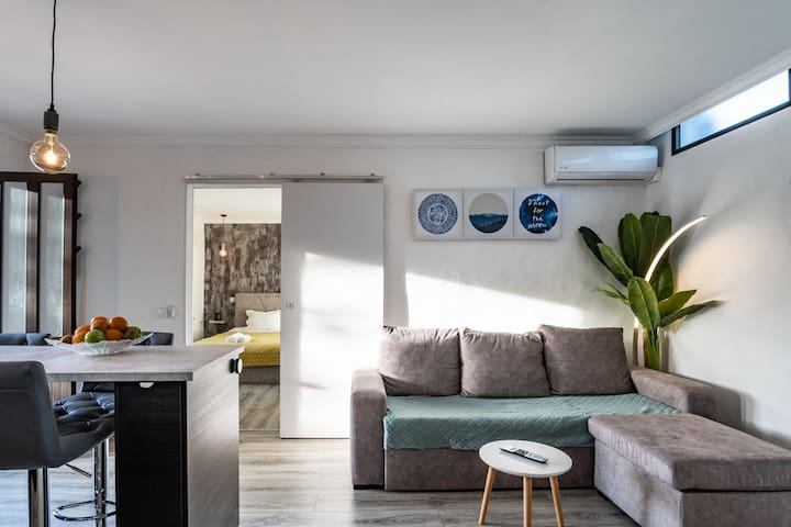 Comfortable furniture , air conditioning, and sofa bed all in this cosy and modern setting with customisable lighting ambience for relaxing evening watching a movie in 4k.