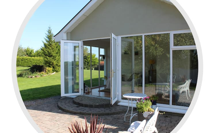 Luxury relaxation with sunroom & private entrance