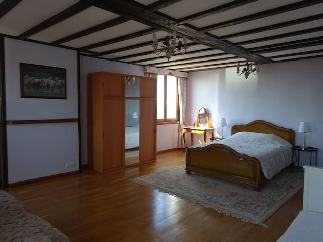 spacious second bedroom with view over village