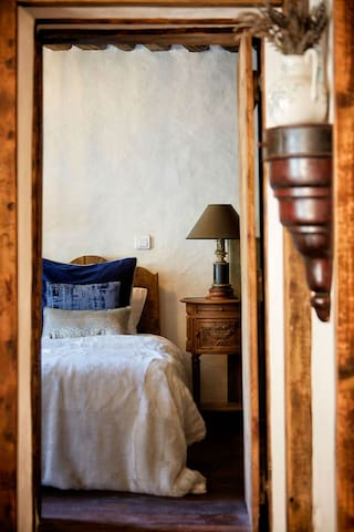 Cloud Room - twin or double bed with ensuite facilities. Fur throws, thick feather filled quilts, pure cotton sheets, a stunning room to sleep & recharge.