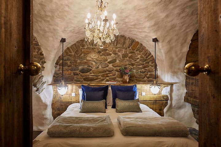Cave Room twin or double - thick mattress, big feather quilts, fur throws, wooden carpets, oak floors, under floor heating and chandeliers - what's not to love about this plush room!