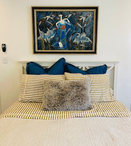 Head board and vintage Crane painting.