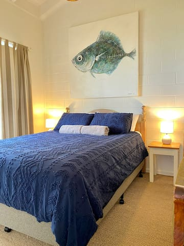 Enjoy the sound of ocean waves at night from the main bedroom.