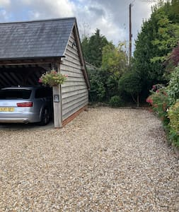 Wide flat parking space on gravel drive