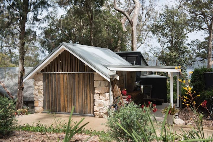 Heritage sandstone cottage with Pittwater views