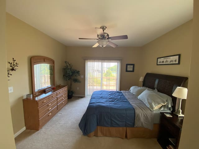 Master Bedroom (Queen) with sliding door deck access and private bathroom with tub and shower.