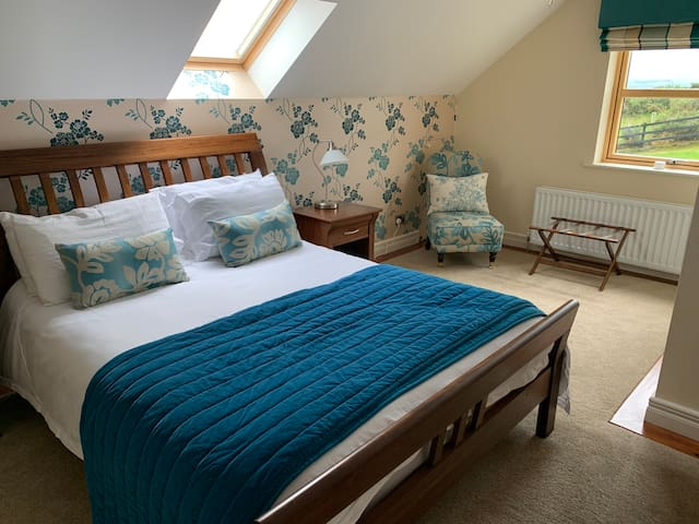 Bedroom No 2 with king size bed.  Mountain and garden views.