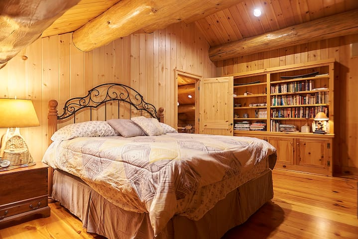 Bedroom on second floor w/ king bed and plenty of books for reading