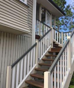 Steps to front door, solar sensor lighting, plus street lighing