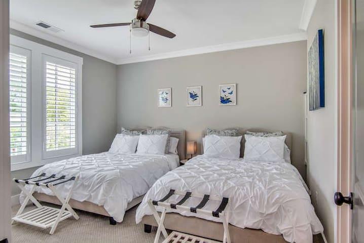 Upstairs bedroom with 2 queen size beds and en-suite bath