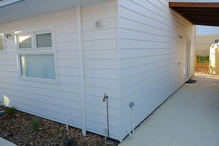 Automatic sensor light on arrival, flat concrete path a minimum of 1.1m wide from driveway to sliding door entrance.