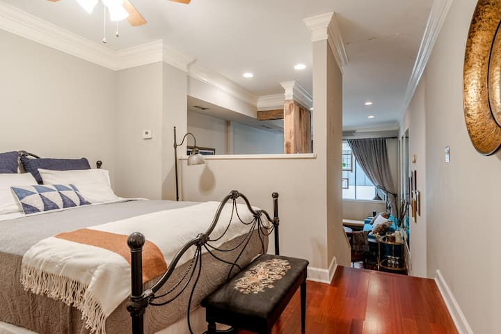 Bedroom with queen bed, dresser, ceiling fan, and small closet