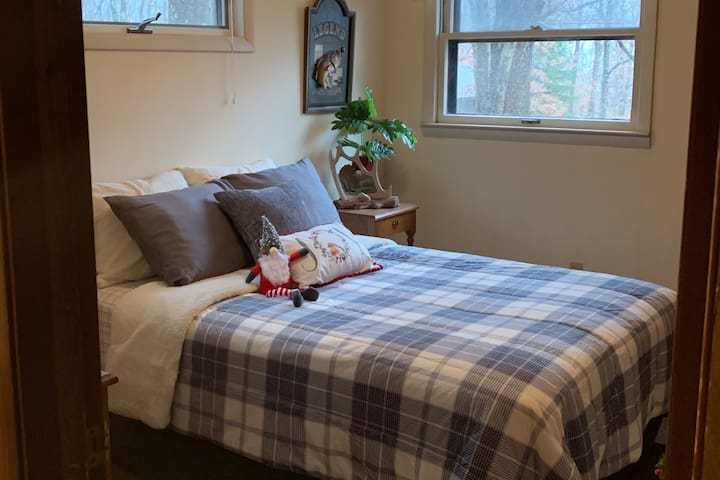 Our guest room features a cozy full-size bed, night-stands, and a chest of drawers for your belongings.