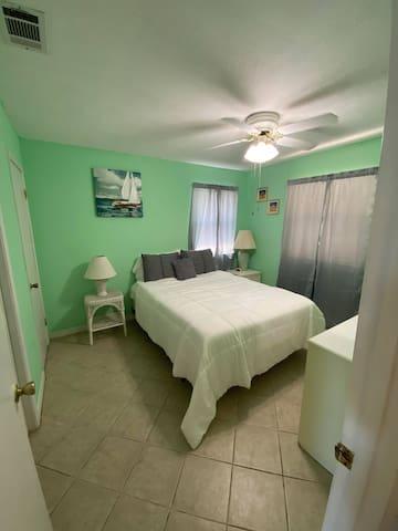 Queen bed with gel mattress topper.