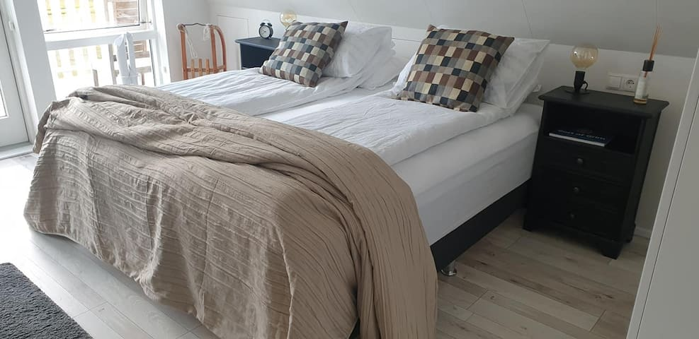 Master bedroom. The bed is 180 cm wide.