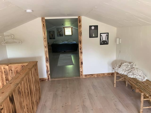 Upstairs, first room