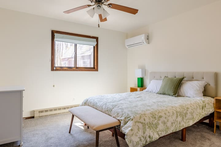 The downstairs bedroom boasts an in-room, remote-controlled heating and cooling system and a large, queen-sized bed.