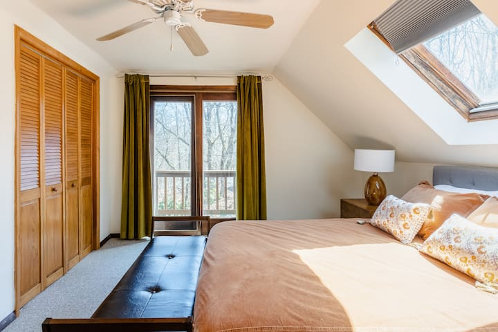 Welcome to the upstairs master bedroom, which features a queen-sized bed.