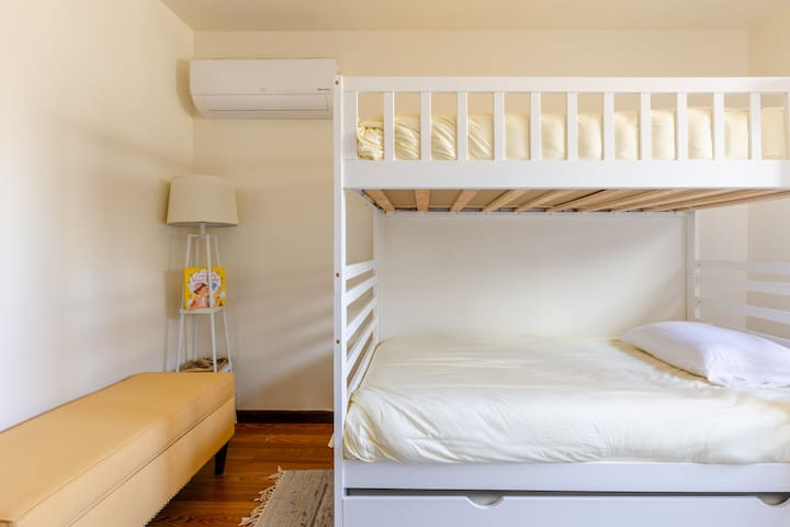 The bunk bed room features a third trundle bed underneath, a remote-controlled AC/heating system as well as a washer and dryer in the closet.